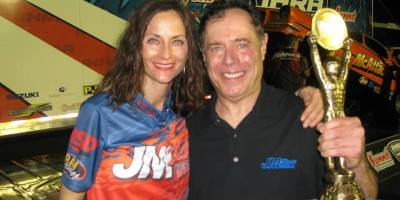 Racer John and Lois Anne Montecalvo celebrate a race victory. Now they'd like to celebrate the return of a dragstrip to Long Island.